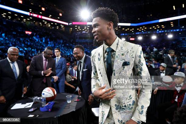 Shai GilgeousAlexander looks on after being selected eleventh by the Charlotte Hornets on June 21 2018 at Barclays Center during the 2018 NBA Draft...