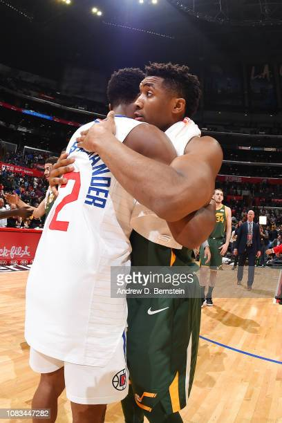 Shai GilgeousAlexander of the LA Clippers and Donovan Mitchell of the Utah Jazz hug after the game on January 16 2019 at STAPLES Center in Los...