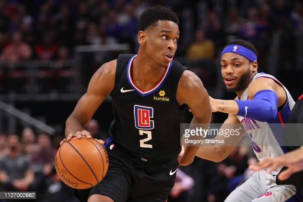 Shai GilgeousAlexander of the LA Clippers drives around Bruce Brown of the Detroit Pistons during the first half at Little Caesars Arena on February...