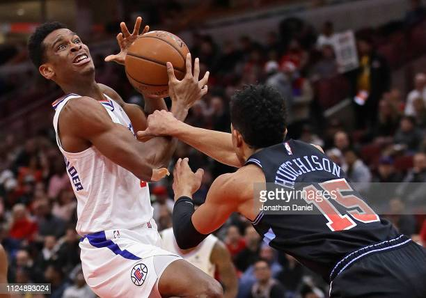 Shai Gilgeous-Alexander of the LA Clippers is grabbed by Chandler Hutchison of the Chicago Bulls at the United Center on January 25, 2019 in Chicago,...