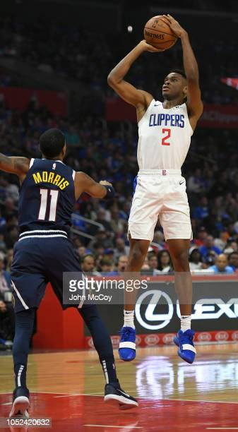 Shai GilgeousAlexander of the LA Clippers shoots over Monte Morris of the Denver Nuggets in the first half during the season opening game at Staples...