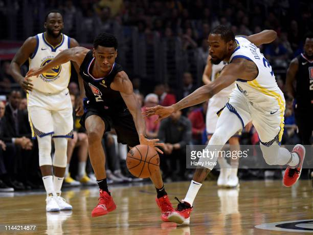Shai GilgeousAlexander of the LA Clippers steals the ball away from Kevin Durant of the Golden State Warriors during the first half in Game Four of...