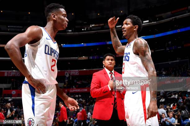 Shai GilgeousAlexander of the LA Clippers talks with DeVaughn AkoonPurcell of the Denver Nuggets against the Denver Nuggets during a preseason game...