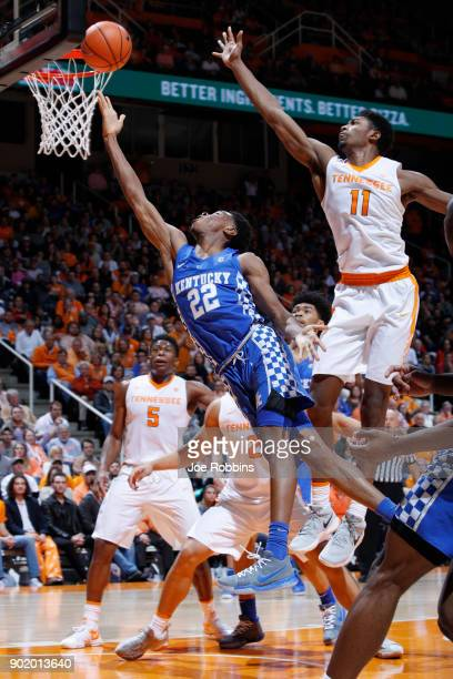 Shai GilgeousAlexander of the Kentucky Wildcats drives to the basket against Kyle Alexander of the Tennessee Volunteers in the second half of a game...