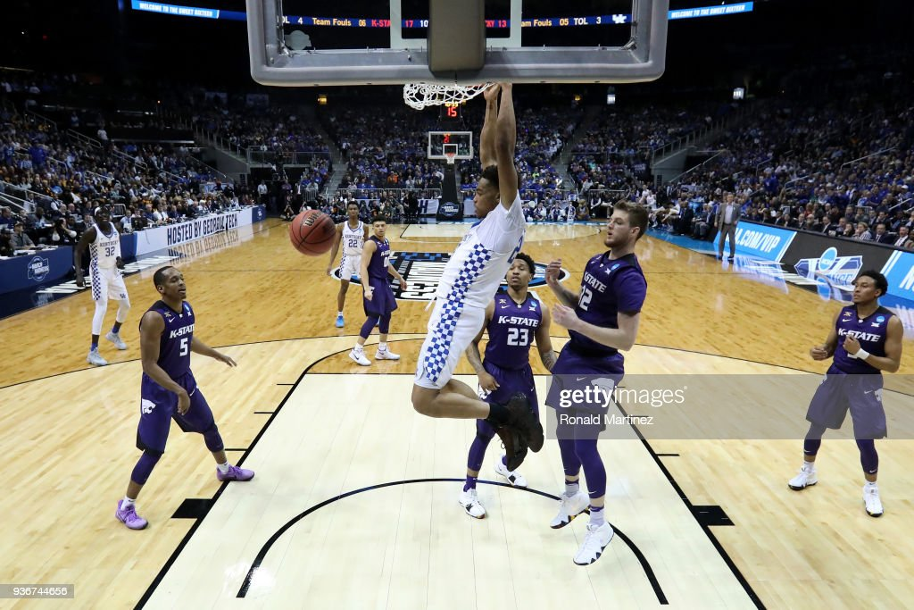 Shai Gilgeous-Alexander #22 of the Kentucky Wildcats dunks in the first half against Dean Wade #32 of the Kansas State Wildcats during the 2018 NCAA Men's Basketball Tournament South Regional at Philips Arena on March 22, 2018 in Atlanta, Georgia.