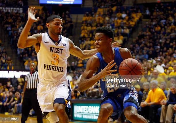 Shai GilgeousAlexander of the Kentucky Wildcats looks to pass against James Bolden of the West Virginia Mountaineers at the WVU Coliseum on January...