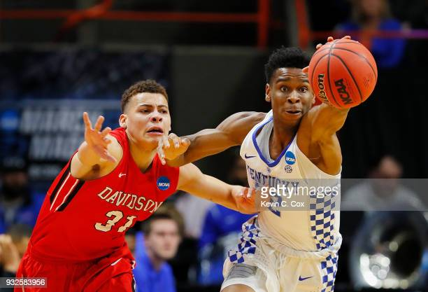 Shai Gilgeous-Alexander of the Kentucky Wildcats steals the ball from Kellan Grady of the Davidson Wildcats in the first half during the first round...