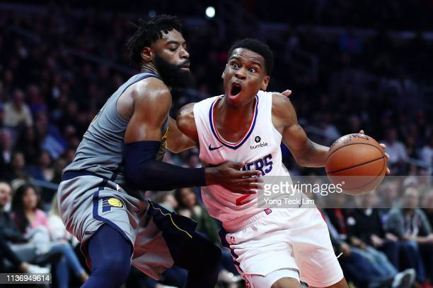 Shai Gilgeous-Alexander of the Los Angeles Clippers drives against Tyreke Evans of the Indiana Pacers during the fourth quarter at Staples Center on...