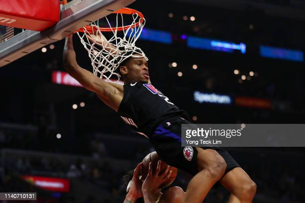Shai GilgeousAlexander of the Los Angeles Clippers dunks the ball against JaVale McGee of the Los Angeles Lakers during the second half at Staples...
