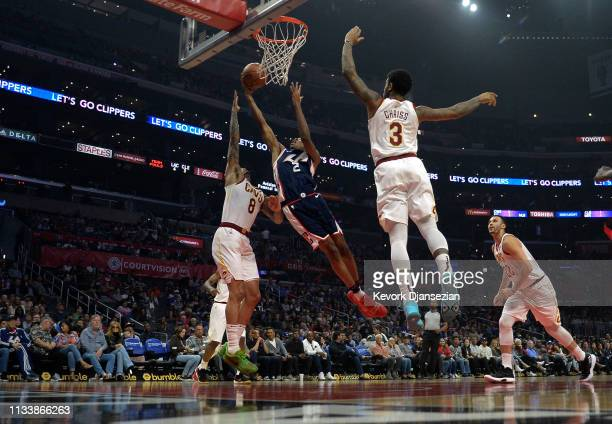 Shai Gilgeous-Alexander of the Los Angeles Clippers scores a basket against Jordan Clarkson of the Cleveland Cavaliers during the first half at...