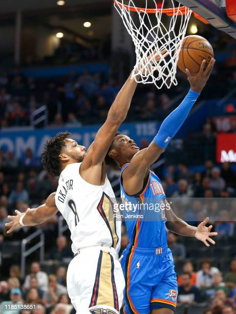 Shai GilgeousAlexander of the Oklahoma City Thunder goes up with a shot as Jahlil Okafor of the New Orleans Pelicans defends during the first half at...
