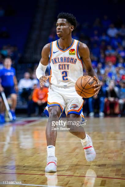 Shai GilgeousAlexander of the Oklahoma City Thunder handles the ball against the Dallas Mavericks on October 8 2019 at BOK Centerin Tulsa Oklahoma...