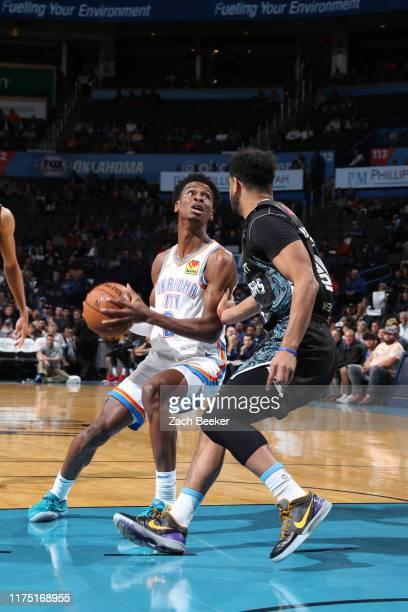Shai Gilgeous-Alexander of the Oklahoma City Thunder handles the ball against the New Zealand Breakers during the preseason on October 10, 2019 at...