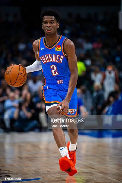 Shai GilgeousAlexander of the Oklahoma City Thunder handles the ball during a preseason game against the Dallas Mavericks on October 14 2019 at the...