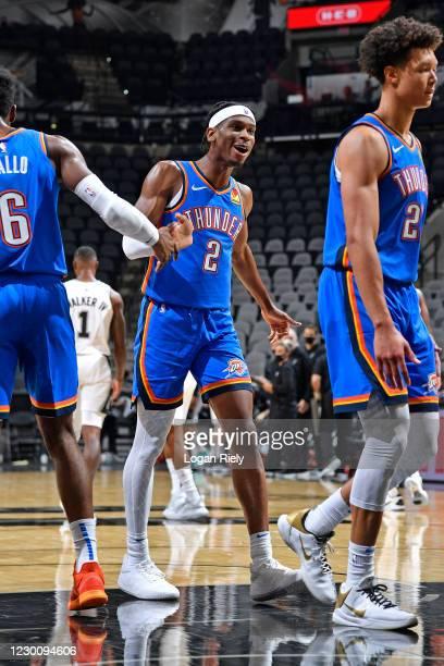 Shai Gilgeous-Alexander of the Oklahoma City Thunder smiles and celebrates with teammates against the San Antonio Spurs during a preseason game on...