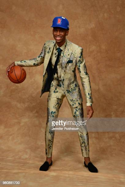 Shai GilgeousAlexander poses for a portrait after being drafted by the LA Clippers during the 2018 NBA Draft on June 21 2018 at Barclays Center in...