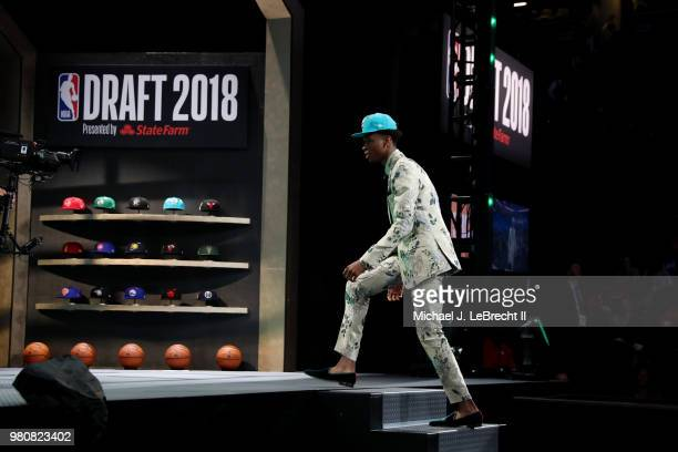 Shai GilgeousAlexander walks the stage after being selected eleventh by the Charlotte Hornets on June 21 2018 at Barclays Center during the 2018 NBA...