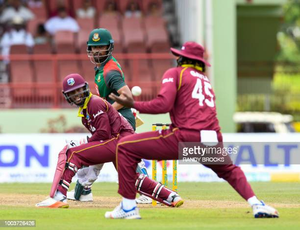 Shai Hope looks back as Chris Gayle of West Indies drops Tamim Iqbal of Bangladesh during the 1st ODI match between West Indies and Bangladesh at...