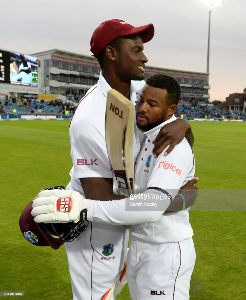 Shai Hope of the West Indies celebrates with captain Jason Holder after winning the 2nd Investec Test between England and the West Indies at Headingley on August 29, 2017 in Leeds, England.