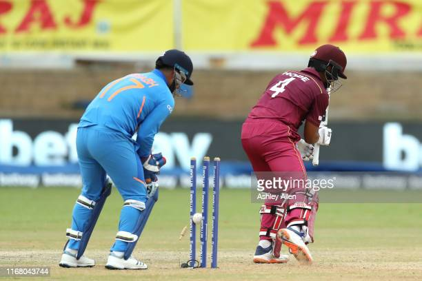 Shai Hope of the West Indies is bowled by Ravindra Jadeja of India during the third MyTeam11 ODI between the West Indies and India at the Queen's...