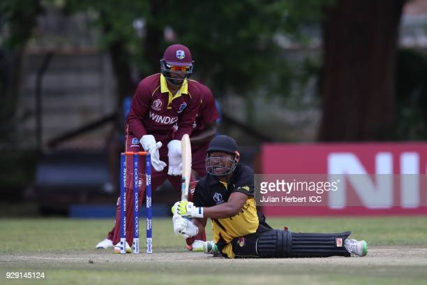 Shai Hope of The West Indies looks on as Assadollah Vala of Papua new Guinea slips during The Cricket World Cup Qualifier between The West Indies and...