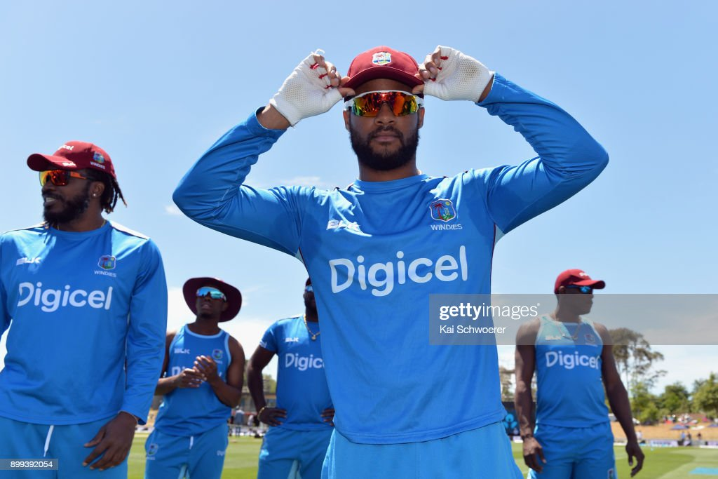 Shai Hope of the West Indies (C) receives his cap from Chris Gayle of the West Indies (L) prior to game one of the Twenty20 series between New Zealand and the West Indies at Saxton Field on December 29, 2017 in Nelson, New Zealand.