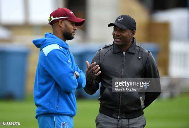 Shai Hope of the West Indies speaks with Brian Lara during a nets session at Lord's Cricket Ground on September 6, 2017 in London, England.