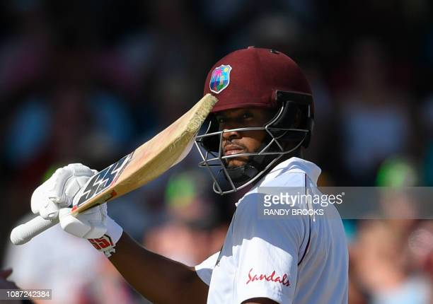 Shai Hope of West Indies celebrates his half century during day 1 of the 1st Test between West Indies and England at Kensington Oval Bridgetown...