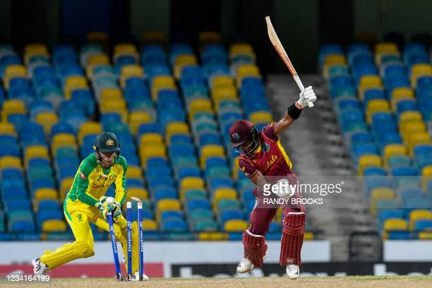 Shai Hope of West Indies is bowled and Alex Carey of Australia watch during the 2nd ODI between West Indies and Australia at Kensington Oval,...