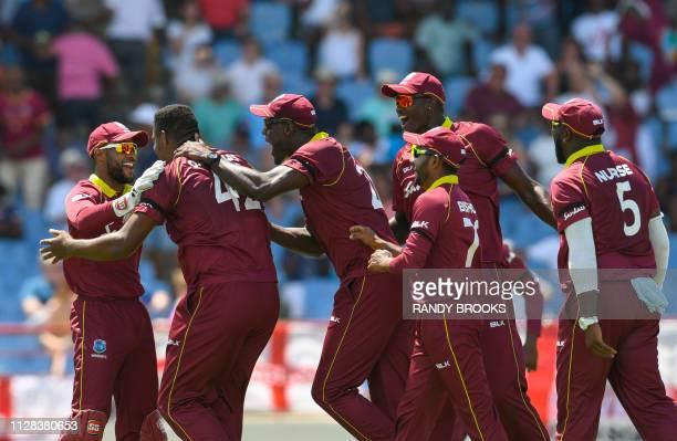Shai Hope Oshane Thomas Carlos Brathwaite Devendra Bishoo Jason Holder and Ashley Nurse of West Indies celebrate the dismissal of Tom Curran of...
