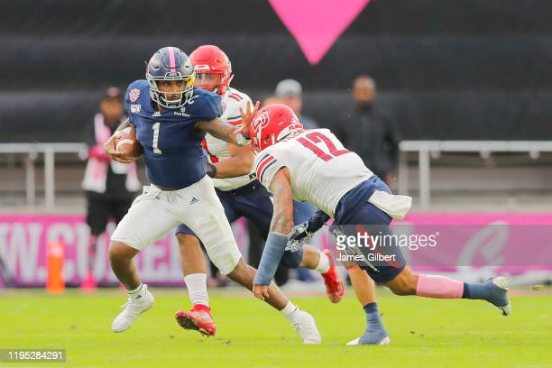 Shai Werts of the Georgia Southern Eagles runs with the ball against Brandon Tillmon of the Liberty Flames during the second quarter of the 2019 Cure...