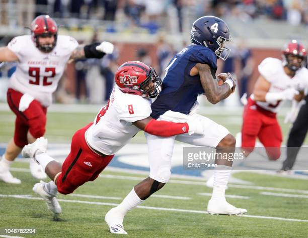 Shai Werts of the Georgia Southern Eagles tries to break free from Ronheen Bingham of the Arkansas State Red Wolves during the first quarter on...