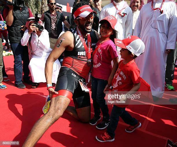 Shaikh Nasser Bin Hamad Al Khalifa of Bahrain reacts with his children after finishing Ironman Bahrain on December 5 2015 in Bahrain Bahrain