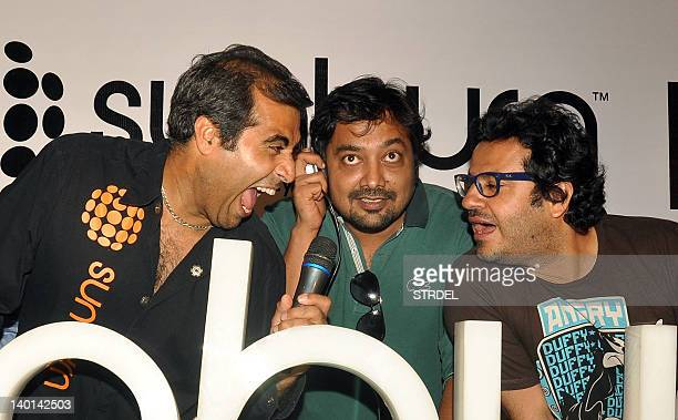 Shailendra Singh Anurag Kashyap and Vikas Bahl pose for photographers at a press conference in Mumbai on February 28 2012 AFP PHOTO/STR