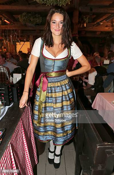 Shailene Woodley wearing a dirndl by 'Amsel fashion' during the Oktoberfest at Kaeferschaenke at Theresienwiese on September 20 2016 in Munich Germany