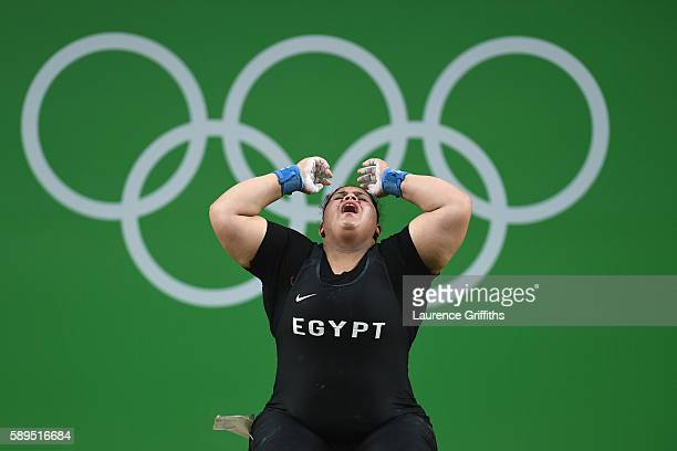 Shaimaa Haridy of Egypt reacts during the Weightlifting Women's 75kg Group A on Day 9 of the Rio 2016 Olympic Games at Riocentro Pavilion 2 on August...