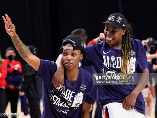 Shaina Pellington and Trinity Baptiste of the Arizona Wildcats celebrate their win over the Indiana Hoosiers in the Elite Eight round of the NCAA...