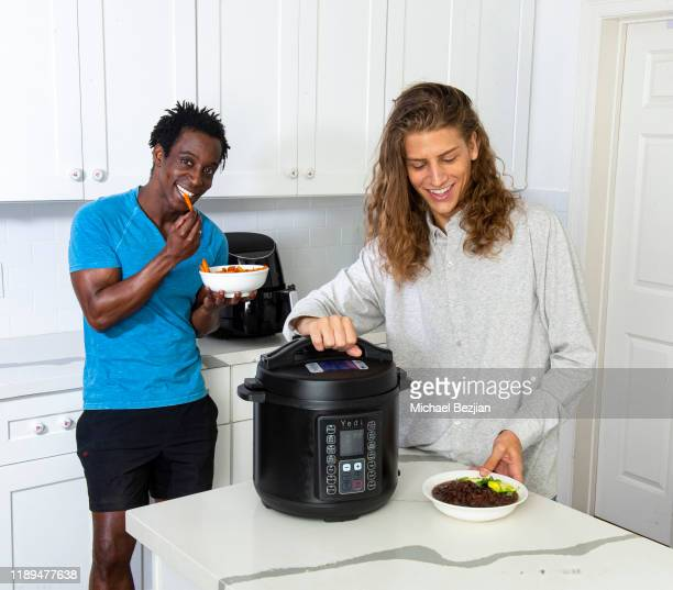Shaka Smith and Hari Tahov cooking with YEDI Houseware MultiFunctional Cooker at the Giveback Day at TAP The Artists Project on November 22 2019 in...