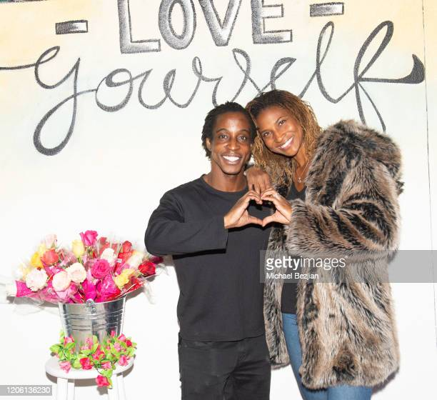 Shaka Smith and Koya Webb pose together at TAP The Artists Project Giveback Day for Face Forward on February 13 2020 in Los Angeles California