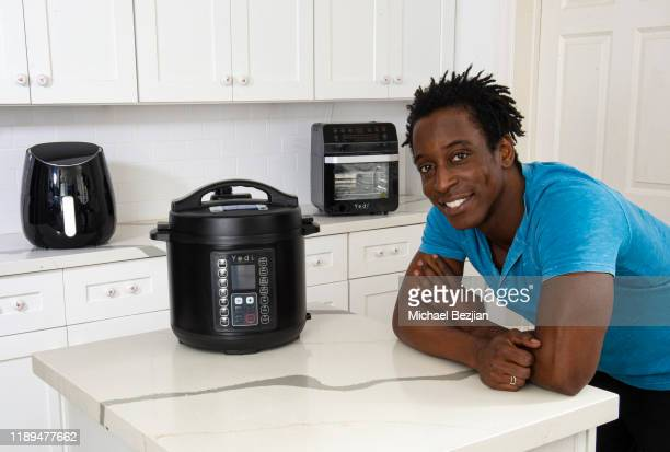 Shaka Smith cooking with YEDI Houseware MultiFunctional Cooker at the Giveback Day at TAP The Artists Project on November 22 2019 in Los Angeles...