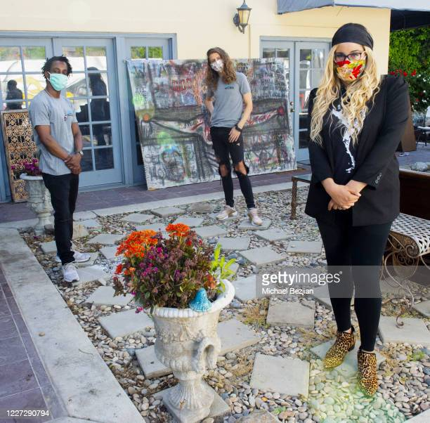 Shaka Smith, Hari Tahov, and Nicole Moore pose for portrait wearing masks by Scarlett St. John at The Artists Report with Ryker and Reese on May 26,...