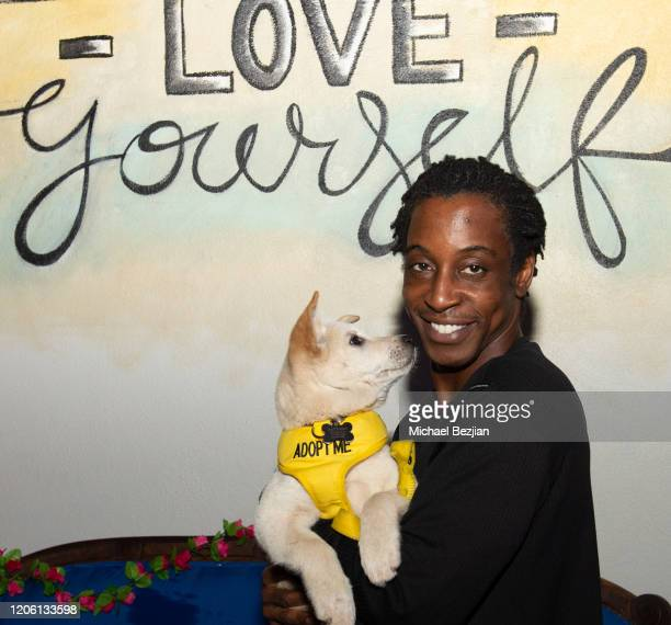 Shaka Smith poses with dog at TAP The Artists Project Giveback Day for Face Forward on February 13 2020 in Los Angeles California