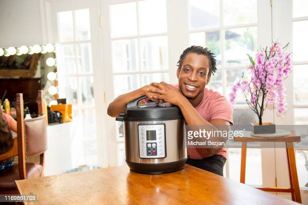 Shaka Smith poses with Yedi Houseware at Giveback Day at TAP The Artists Project on August 23 2019 in Los Angeles California