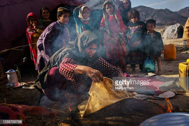 Shakaria, first game only, makes fresh bread at an IDP Camp in Panjwayi District, Afghanistan, Tuesday, May 4, 2021. The city of Kandahar, once the...