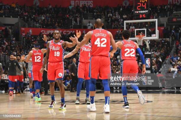 Shake Milton and Al Horford of the Philadelphia 76ers hifive during the game against the LA Clippers on March 1 2020 at STAPLES Center in Los Angeles...