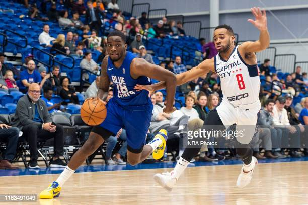 Shake Milton of the Delaware Blue Coats drives to the basket on Phil Booth of the Capital City GoGo during an NBA G League game on November 18 2019...