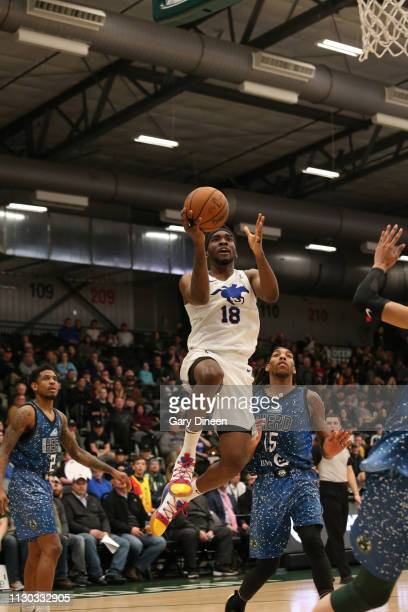 Shake Milton of the Delaware Blue Coats shoots against Michael Qualls of the Wisconsin Herd during the G League game at the Menominee Nation Arena on...