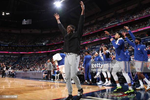 Shake Milton of the Philadelphia 76ers and the Philadelphia 76ers bench celebrates during the game against the New Orleans Pelicans on October 20,...