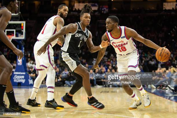 Shake Milton of the Philadelphia 76ers dribbles past Lonnie Walker IV of the San Antonio Spurs during the fourth quarter of a game at the Wells Fargo...