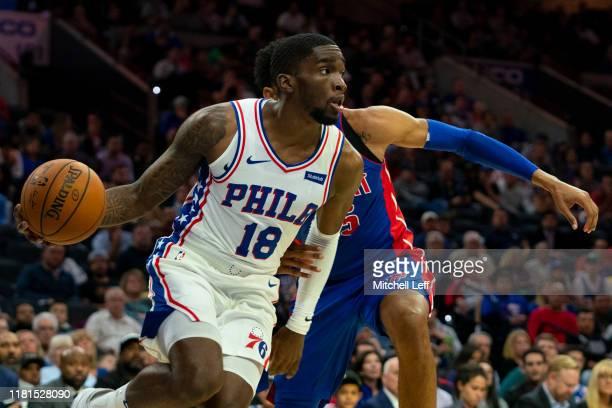 Shake Milton of the Philadelphia 76ers dribbles the ball against Christian Wood of the Detroit Pistons during the preseason game at the Wells Fargo...